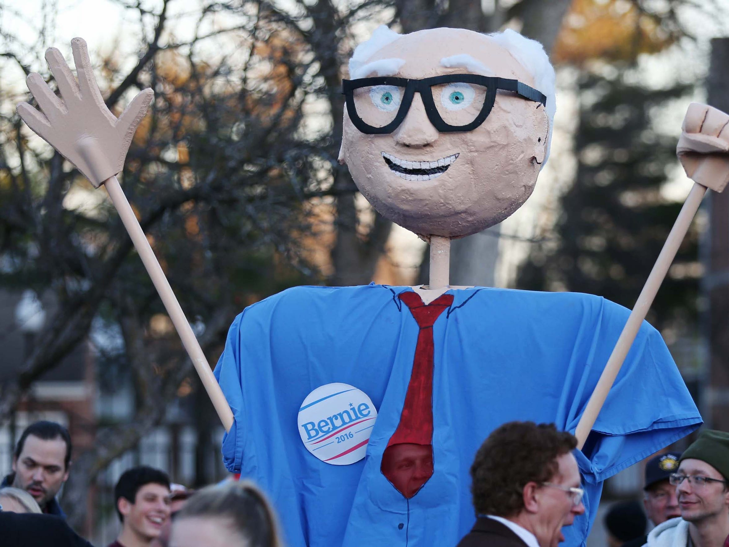 A man dressed as a larger-than-life Bernie Sanders attends a rally for the presidential hopeful ahead of the Democratic Debate on Saturday, Nov. 14, 2015, in Des Moines.