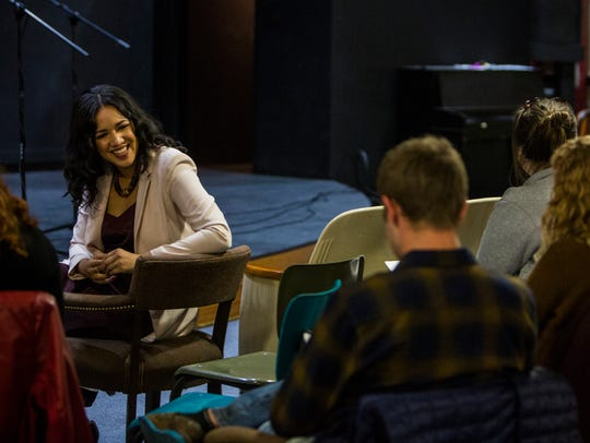 Tiana Clark leads a discussion during a Treehouse Poets