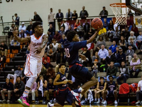 Darius Garland of Brentwood Academy goes in for the