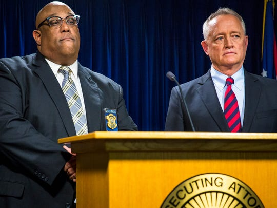 Cincinnati Police Chief Eliot Isaac and Hamilton County Prosecutor Joe Deters answer questions about the Walnut Hills officer-involved shooting at a press conference at the Hamilton County Prosecutor's Office Tuesday, March 21, 2017.