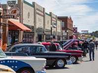 Classic cars line Route 66 in downtown Williams for August's Cool Country Cruise In.