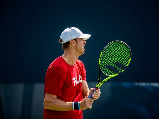 Sam Querrey practices with Austin Hussey on his off