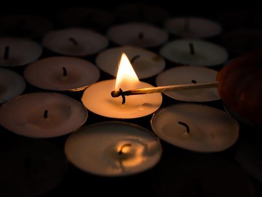 Match lighting tea light candle