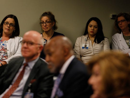 Nashville General Hospital employees listen during