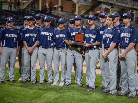 The Piedra Vista Panthers pose with the 6A state runner-up trophy Saturday at Isotopes Park in Albuquerque.
