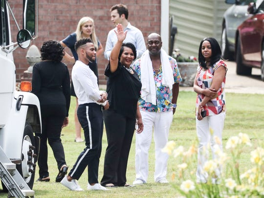 "Alice Marie Johnson waves goodbye to reality star Kim Kardashian West, who visited to meet with Johnson and film an interview with the ""Today"" show, on June 13, 2018. Kardashian West was instrumental in getting President Donald Trump to grant clemency to the 63-year-old grandmother, who received a life sentence in 1996 for her role in a drug trafficking organization."