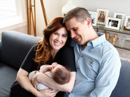 Dan Pfeiffer, former adviser to President Barack Obama, at home with his wife Howli and newborn daughter Kyla.