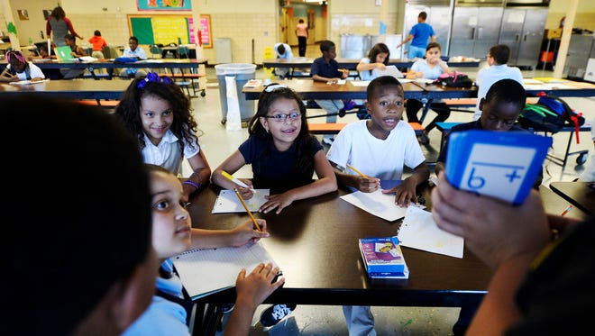 8-year-olds practice multiplication with flash cards during homework time during the afterschool program at Devers Elementary School in York  on Tuesday, October 6, 2015.
