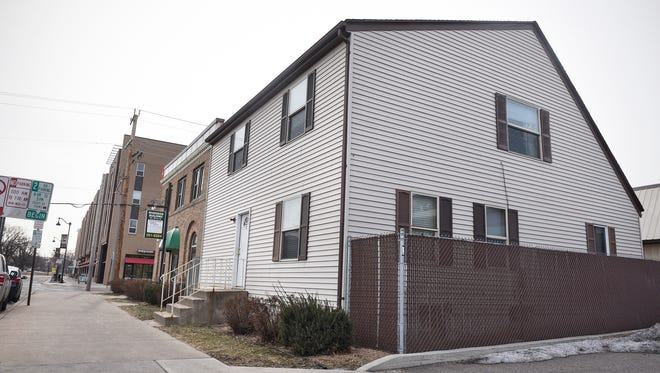 The building at 225 Fifth Ave. S in St. Cloud is shown Monday, Feb. 27. A developer has plans to demolish the triplex to make space for a drive-through coffee shop in the building at 211 Fifth Ave. S.