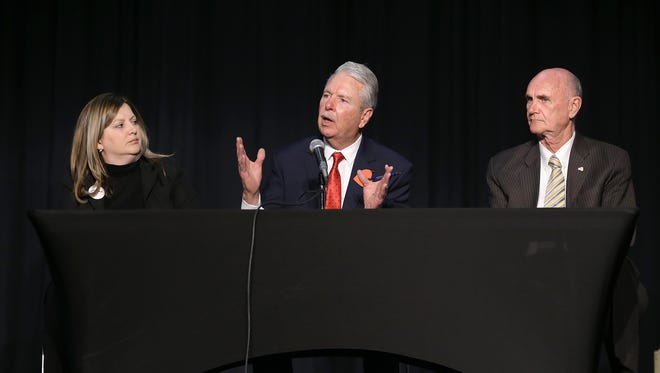 Three Democrats, attorney Laura Enriquez, left, businessman Ricardo Samaniego, center, and former El Paso Mayor John Cook, attend a candidate forum for county judge Feb. 7 at the El Paso Community College Transmountain campus. The candidates agreed on every topic, including Senate Bill 4, immigration and unincorporated county issues.