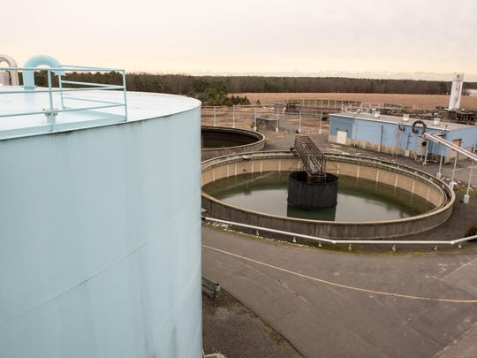 The former Ciba-Geigy Corp. Superfund site in Toms River, NJ, is now owned by BASF. Currently on the site BASF runs a new groundwater treatment system. This is a view of a basin (right) that was part of the chemical removal process but is no longer in use. At left is a Final Effluent tank, (part of the new system) used to house clean water. /Russ DeSantis for the Asbury Park Press / Slug: ASB 0221 Former Ciba property