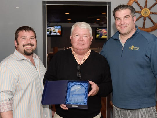 Jim Flynn (center), founder of Jersey Shore Restaurant Week and Shorefoodie.com, presents an award to John Hilla (left) and Joe Introna of Joe Leone's Italian Specialties in Point Pleasant Beach and Sea Girt during a past Shorefoodie.com TASTE Awards.
