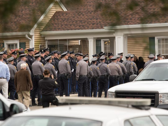 Police officers line up to enter the funeral home. Sgt. Alison Wray of the Berkeley Township Police Department died suddenly Nov. 3 after she suffered a stroke while on duty. The viewing was held at the Quinn Hopping Funeral Home in Toms River on Thursday, November 9, 2017. /Russ DeSantis for the Asbury Park Press / Slug:Sgt. Alison Wray Funeral