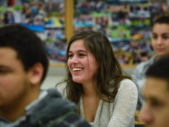 Senior Briana Vieira has a laugh as U.S. Rep. Frank Pallone answers her question. Pallone visited an Advanced Placement class to talk with students at Long Branch High School Tuesday.