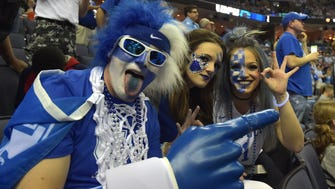 Kentucky Wildcats fans cheer on their team before the first half against the North Carolina Tar Heels.