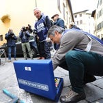 Italian police continue an investigation outside the apartment of 35-year-old American Ashley Olsen into her death in Florence, Italy, Jan. 11, 2016.
