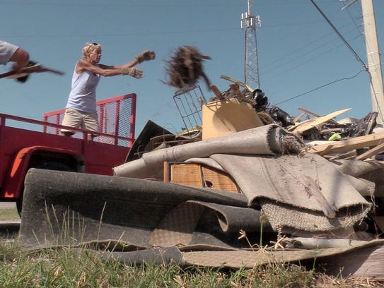 09/18/17-Marathon, Florida—Residents throw debris from