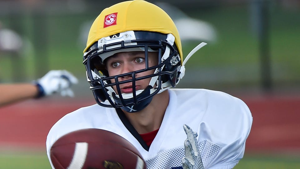 Greencastle's Kyrin Zimmerman catches the football