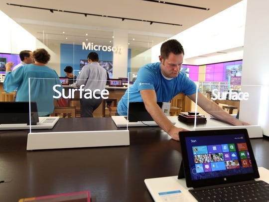 Tim Thews, Microsoft store manager, makes some adjustments on the Surface RT tablet display area on Friday June,28, 2013.