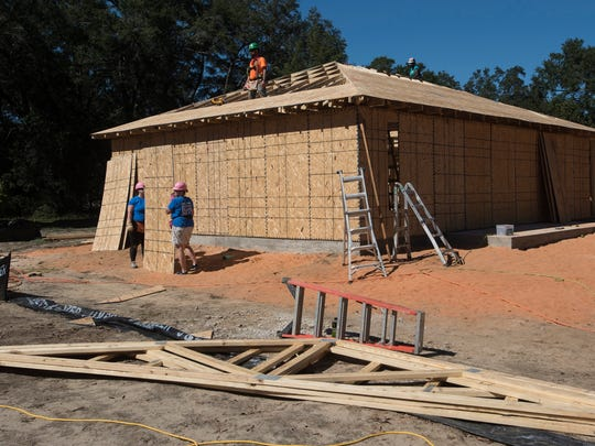 Local ladies volunteer their time with Habitat for Humanity building a new home on the Women's Build project in Milton Wednesday, Oct. 17, 2017.
