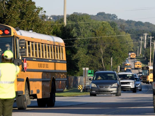 A long line of cars and school busses on Arno Road forms in front of Page High School on Thursday, Sept. 7, 2017.
