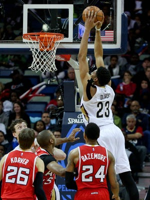Anthony Davis slams home two of his game-high 29 points.