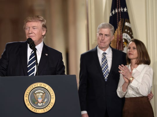 Judge Neil Gorsuch and his wife Marie Louise look on,