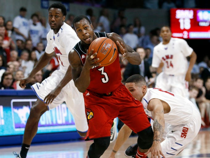 Louisville guard Chris Jones (3) picks up a ball lost by SMU guard Nic Moore, right, during the first half of an NCAA college basketball game Wednesday, March 5, 2014, in Dallas. (AP Photo/John F. Rhodes)