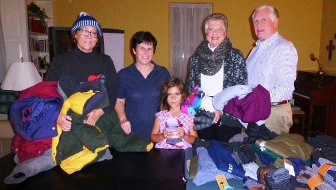 (From left) Dawn Amari, Cathy Gardner, Maddie Helland, Darlene Morvay and Ed Morvay are pictured with donations from Lutheran Church of the Redeemer for Vineland's Code Blue Program to help area homeless  people.
