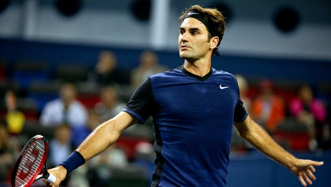 Roger Federer of Switzerland reacts while playing against Albert Ramos-Vinolas of Spain during their match at the Shanghai Masters.