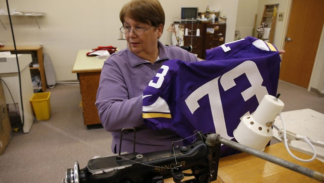 Penny Bryce works Friday on a Minnesota Vikings jersey in Hopkins. From Tarkenton to Bridgewater, Bryce's garment lettering shop has been sewing the names on the backs of the Minnesota Vikings since 1969.