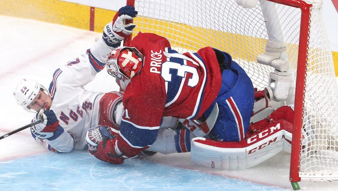 New York Rangers left wing Chris Kreider crashes into Montreal Canadiens goalie Carey Price during Game 1 of the Eastern Conference Final.
