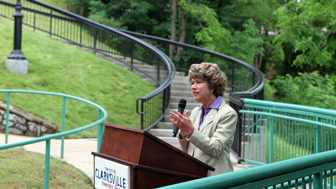 Mayor Kim McMillan dedicated a new section of Clarksville's Upland Trail Wednesday. The steps behind her connect downtown sidewalks to Clarksville's Upland Trail and Greenway system.