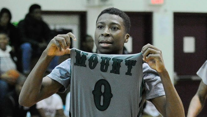 Mount Pleasant's Raheim Burnett wears No. 0, but his Green Knights are ranked No. 1 in boys basketball by The News Journal.