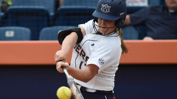 Kasey Cooper (13) hits during a home game against Texas A&M on Sunday, April 27, 2014.