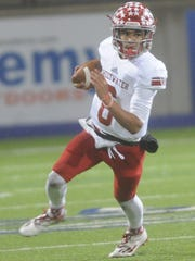 Sweetwater quarterback Chris Thompson looks for running