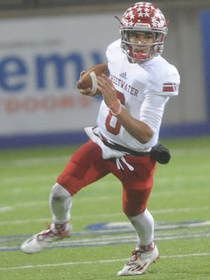 Sweetwater quarterback Chris Thompson looks for running room against the Seminole defense. Sweetwater won the Class 4A Division II state quarterfinal game 38-14 on a cold, wet night Friday, Dec. 2, 2016 in Midland.