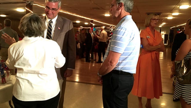 Gubernatorial candidate Eric Holcomb meets with Republican Party members at Vanderburgh County's Reagan Day Dinner on Saturday.