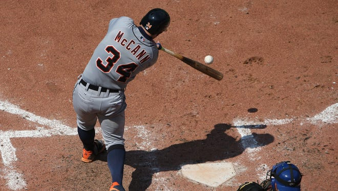 Tigers catcher James McCann hits an RBI groundout in the seventh inning of the 9-2 loss to the Blue Jays Sunday in Toronto.