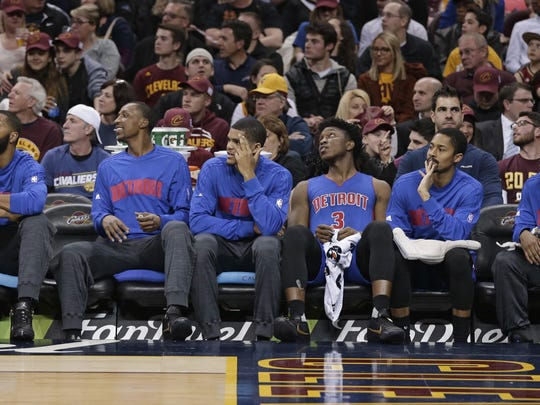 The Detroit Pistons starters watch from the bench during the first half of an NBA basketball game against the Cleveland Cavaliers, Wednesday.