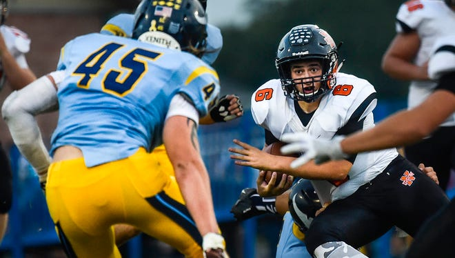 North Union quarterback Tim Gilliland runs the ball to avoid oncoming River Valley players during a Mid Ohio Athletic Conference game last season. This could be the final season in the MOAC for North Union.