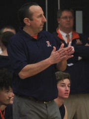 Beech boys basketball coach Kip applauds a play as