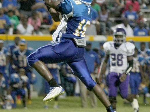 North Side's Jacobe Eckford leaps to make a catch against Ripley.