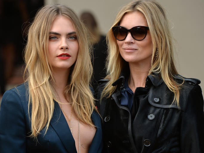 Cara Delevingne and Kate Moss attend the Burberry Prorsum show during London Fashion Week Spring Summer 2015 on Sept. 15, 2014, in London, England.