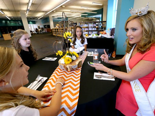 Miss Tennessee 2016, Grace Burgess, right, has lunch with Milddle Tennessee Christian School students (L to R) Anna Claire Stephen, Aubrey Merritt and Miss Tennessee Preteen, Brookelyn Pedigo on Thursday, Oct. 13, 2016, during Burgess' appearance at the school. The students won an auction to have lunch with Miss Tennessee.