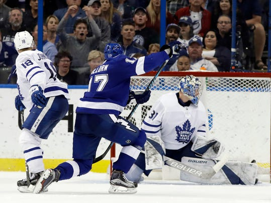 Tampa Bay Lightning left wing Alex Killorn (17) fires the puck past Toronto Maple Leafs goaltender Frederik Andersen (31) for a goal during the third period of an NHL hockey game Tuesday, March 20, 2018, in Tampa, Fla. The Lightning won the game 4-3. Defending for Toronto is Andreas Johnsson (18). (AP Photo/Chris O'Meara)
