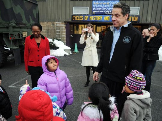 Gov. Andrew Cuomo greets children in Poughkeepsie's Catharine Street Community Center, which runs an after-school and universal pre-K program, in December, after helping distribute items from the New York State Toys, Coats and School Supplies Drive.