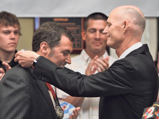Shaw Development President Kevin Hawkesworth is presented with the Governor's Business Ambassador Award by Florida Governor Rick Scott in Bonita Springs Friday.