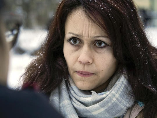 """Lyudmila Savchuk, former troll and researcher speaks to journalists in St.Petersburg, Russia, Monday, Feb. 19, 2018. Savchuk, who was employed by the domestic department of the """"troll farm"""", said that her experience with it corresponded with the allegations made by the U.S. indictment. """"The posts and comments are made to form the opinion of Russian citizens regarding certain issues, and as we see it works for other countries, too,"""" she told the AP."""