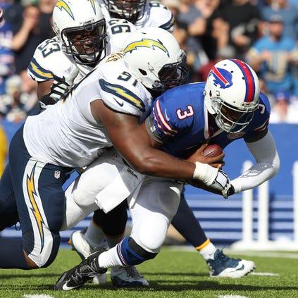 San Diego Chargers defensive end Kendall Reyes (91) sacks Buffalo Bills quarterback EJ Manuel (3) during the second half at Ralph Wilson Stadium. San Diego beats Buffalo 22 to 10.